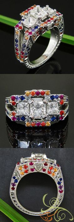 Colorfully inspired ring with rainbow array of Sapphires, halo set around 3 stone center Mounting