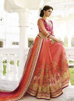 Amazing Rani Colored Satin Georgette Saree, It Has A Tint Of Peach In The Net Skirt And Is Paired With A Rani Colored Dupion Blouse. You Will Love The Drape On You And It Is Just The Outfit You Need In This Wedding Season.