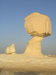 "White Desert: Alien landscape of chalk-rock in the Egyptian Desert -- Arguably the most characteristic of these peculiar natural formations is the famed ""chicken and tree"" set, also called ""chicken and mushroom,"" or, better yet, ""chicken and atomic bomb."" Only in The White Desert will you encounter such a bizarre and awe-inspiring natural museum of chalk-rock."