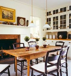 pine table with black chairs, charming