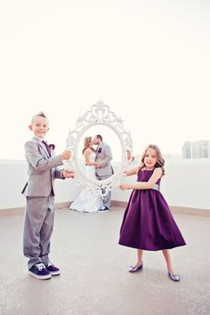 These kids are too cute!  Baroque framed couple.  Photograph by Moxie Studio  http://www.storyboardwedding.com/vintage-glam-at-the-height-of-the-las-vegas-strip-clad-in-deep-purples-soft-greys/