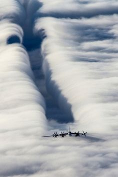 Clouds and Tu-95.  minimalism: design or style in which the simplest and fewest elements are used to create the maximum effect