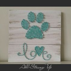 Thanks for looking. Aqua paw print with love String Art, Made by hand with love in NSW, Australia. Find the rest of my pictures at the following places.  Find my website at www.allstrungup.com.au Find me on Instagram at https://www.instagram.com/all_strung_up/ Find me on Facebook at https://www.facebook.com/All-Strung-Up-915873695199667/?ref=hl