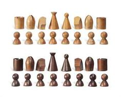A WALNUT AND BEECH CHESS SET