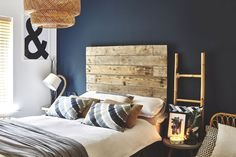 Bedroom clutter destroying your chances of a restful bedtime? Bedroom storage ideas: Spare bedroom with supersize wooden pallet headboard against dark navy wall, ladder shelving and rattan pendant light Furniture, Bedroom Themes, Organization Bedroom, Bedroom Storage, Bedroom Diy, Bedroom Furniture, Stylish Bedroom, Small Bedroom, Bedroom Vintage