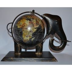 This quirky small black elephant globe was made by a small family run business in India and the product itself is fairly traded. A very unusual and unique piece, would be perfect to add character to any room. The approximate size of this globe is 20 x 10 x 20 cm.