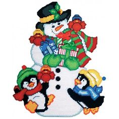 snowman friends plastic canvas kit snowman has plenty of presents to share with his little penguin friends