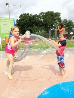 Going crazy at Rio Vista Swimming Pool, which has spray park features as well!