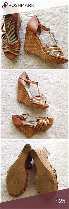Jessica Simpson Must Have Brown & Gold Wedges Wedges bought at Dillards. Worn all the time(-: There is wear on the bottom of the shoes (see pic #3).  There are also a few marks on the backside of right wedge (see pic #4). Shoes are still in GOOD CONDITION. Feel free to ask questions or make an offer. 🚫NO TRADES🚫 Jessica Simpson Shoes Wedges