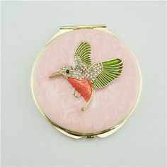 Bird series crystal compact mirror/Small pocket mirror This gold plated compact mirror is a perfect gift for lady. It is covered with pink enamel glaze and mounted with bling-bling crystals. There are two mirrors inside.