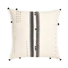 Injiri Rebari Khadi Pillow Each Injiri pillow is entirely handmade by local artisans using traditional techniques of weaving, dying, and looming. Adornments add a personal, hand-applied touch. Made in India.