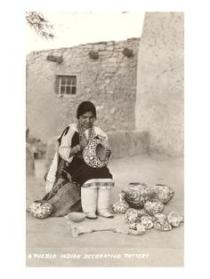 Acoma Pueblo Indian Woman Decorating Pottery.