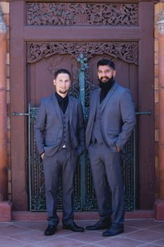 Groom and groomsman in black shirts and ties - great look!