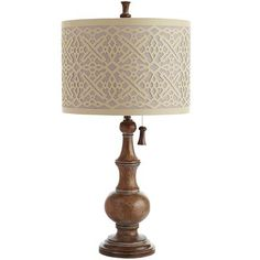 It won't grant you three wishes, but with a lamp this gorgeous, who could ask for more? The shade is a stylized interpretation of a tribal Kuba cloth done in laser-cut linen. And, the chain pull adds a touch even a genie would love.