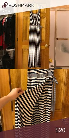 Old Navy Maxi Dress (navy blue and white stripe) The colors are Mavy Blue and White, very nautical feel, great for summer or for someone who loves where it's warm year round. Slit up the side but Dress over laps so not to show anything not wanted. Old Navy Dresses Maxi