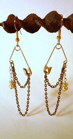 Safety Pin Earrings I can see these with some sewing/crafting charms on them. =)