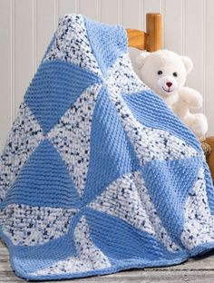 Free Knitting Pattern for Easy Pinwheel Baby Blanket - This easy colorful and reversible blanket is made of squares knit diagonally in garter stitch in two colors and then seamed to form pinwheel shapes. Designed by Premier Yarns Design Team for bulky yarn. Finished size 32 inches square.