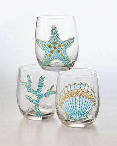 Alert: Under the Sea I think I'm going to make these with glass paint pens. From Elle Decor.I think I'm going to make these with glass paint pens. From Elle Decor. Glass Paint Pens, Painting On Glass Bottles, How To Paint Glass, Painted Bottles, Posca Marker, Painted Wine Glasses, Beach Crafts, Beach House Decor, Elle Decor