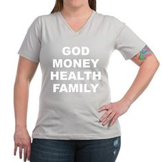 Women's dark color silver v-neck t-shirt with God Money Health Family theme. God Money Health Family is the main order the average person place their values and priorities in. Available in black, silver, navy blue, charcoal, Kelly green, coral, garnet; small, medium, large, x-large, 2x-large, 3x-large for only $25.99. Go to the link to purchase the product and to see other options – http://www.cafepress.com/stgmhf