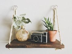 Our modern hanging shelves are perfect for those looking to add a modern bohemian touch to their home. This minimalist shelf is 100% handcrafted in Colorado Springs with stain and natural materials. - Rustic Modern Hanging Shelf - Espresso Stain - 100% Natural Compostable Rope - Each