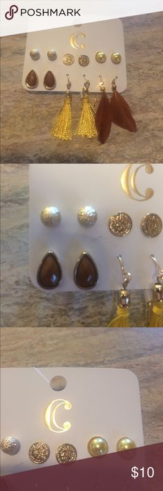 NEW 6 Earring Set Beautiful set of earrings includes shimmery gold balls, gold coins, pale yellow raised semicircles with gold trim, brown and gold tear drops, gold tassels (thread) and brown feathers. This is a great value and would make a good set of travel earrings too! Charming Charlie Jewelry Earrings
