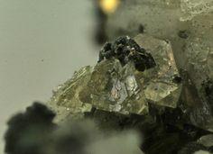 Daqingshanite, (Sr,Ca,Ba)3(Ce,La)(PO4)(CO3)3-x(OH,F)x, Mont Saint Hilaire, Québec, Canada. Yellowish, translucent crystal cluster of sharp tetrahedrons,