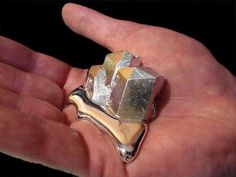 Cheap gifts guaranteed to impress science geeks: Gallium   is a silvery metal with atomic number 31. It's used in semiconductors and LEDs, but the cool thing about it is its melting point, which is only about 85 degrees Fahrenheit. If you hold a solid gallium crystal in your hand, your body heat will cause it to slowly melt into a silvery metallic puddle. Pour it into a dish, and it freezes back into a solid.    While you probably shouldn't lick your fingers after playing with it, gallium is...