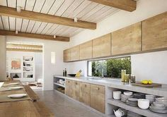 Open single wall kitchen with beamed ceiling