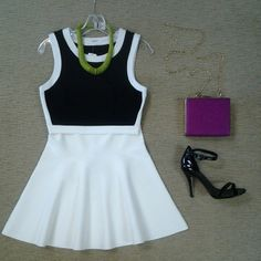 Bailey 44 black and white crop top, BCBG Ingrid fit and flare skirt, black patent strappy sandal, hot pink box handbag, and chartreuse wooden disc necklace