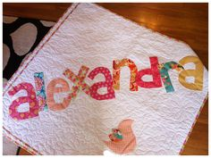 An original Cotton and Clover personalized name quilt.  100% yummy cotton, machine wash and dry...