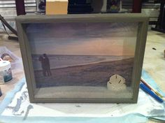 Simple shadow box turned into a memory! Fill with sand and seashells from a beach trip and hang for viewing!