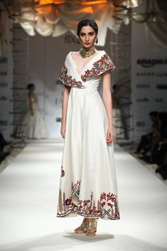 Ivory thread and zari embroidered off shoulder gown available only at Pernia's Pop Up Shop. Indian Fashion Trends, Asian Fashion, Girl Fashion, Fashion Outfits, India Fashion Week, Lakme Fashion Week, Indian Attire, Indian Wear, Indian Dresses