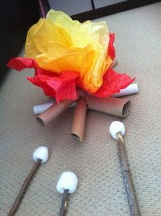 Spring theme: Camping or forests. Paper towel rolls, tissue paper, and cotton balls on sticks make this fun indoor camp fire! Camping Dramatic Play, Dramatic Play Area, Dramatic Play Centers, Prop Box, Niklas, Play Centre, Imaginative Play, Preschool Activities, Preschool Camping Theme