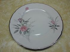 Place setting for 18, large and small plates, bowls, 4 cups and saucers