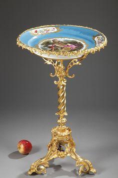 A pedestal porcelain and gilt bronze of a love scene.