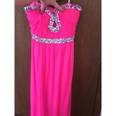 Hot pink prom dress This Fred is NWT. It does have a few flaws. There are 2 loose stones and 1 missing. I will send a gem to replace it. Little snag but not noticeable. Perfect for prom or formal dance! Dresses Prom