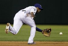 Texas Rangers shortstop Elvis Andrus chases down a double play ball from Tampa Bay Rays' Evan Longoria in the sixth inning of a baseball game Saturday, April 28, 2012, in Arlington, Texas. The Rays' Carlos Pena was out at second on the play. (AP Photo/Tony Gutierrez) game 21