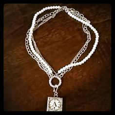 Cute silver and pearl necklace! The A charm can be removed and replaced with another charm. This necklsce has a pearl strand and 3 silver strands. Antique looking charm! Jewelry Necklaces