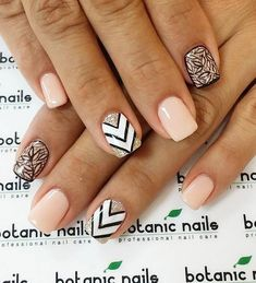 Nude nail polish in combination with black and white nail polish. Geometric shapes and leaves make this nail art design so interesting to look at. The glitter polish added help make it stand out more.