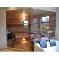 """Custom sauna door with glass wallsThis sauna design is super clean and showcases the natural beauty of the cedarPlease call from custom glass door and wall quotesAllow 4-6 weeks for delivery of custom sauna glass doors and walls. Constructed out of 3/8"""" tempered glass"""