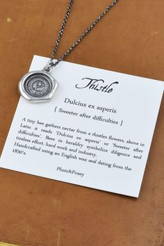 Hey, I found this really awesome Etsy listing at https://www.etsy.com/listing/151266917/thistle-wax-seal-crest-necklace-in-latin