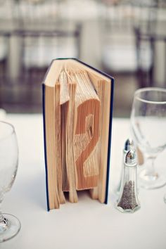 How cool is this? #TableNumbers etched in vintage books I A Good Affair Wedding and Event Production I #tablenames
