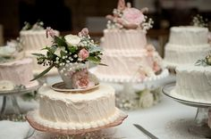 Lovely... small cakes surrounding the main cake, with tea cups & fresh flowers. A tea cup of the bride's china would be perfection & an amazing gift for each of your bridesmaids! The blush pink icing is very pretty!