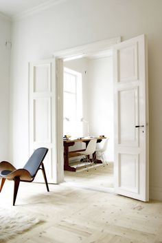 Love the doors. Could use molding to existing plain front door to create squares, then paint. Hummm
