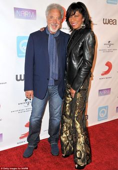 Legends then and now: Tom Jones posed with Natalie Cole at the event, which took place at the Hyatt Regency Century Plaza.....They are not together but they do make a handsome couple.
