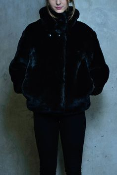 This Parisian runway inspired faux fur jacket boasts a cutting edge style with four snap button closure along the high funnel neck. Pockets along the side seam and comfortable plush feel of this jacket makes it a wardrobe staple. Funnel Neck, Faux Fur Jacket, S Models, Wardrobe Staples, Parisian, Winter Jackets, Link, Board, How To Wear