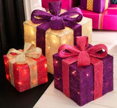 With cute pink and purple colours these elegant and charming light up gift boxes will add a Christmas sparkle to any room.