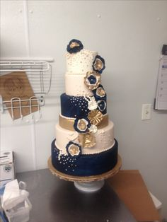 Navy blue and gold wedding cake
