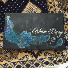 Limited Edition Urban Decay Eyeshadow Palette Beautiful Peacock Urban Decay Eyeshadow palette with 6 unique colors! So beautiful and barely used. Comes with eyeliner Urban Decay Makeup Eyeshadow