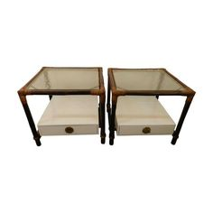 A pair of vintage Ficks Reed side tables with original brass hardware which has Chinoiserie over tones.  These are perfect for any room!